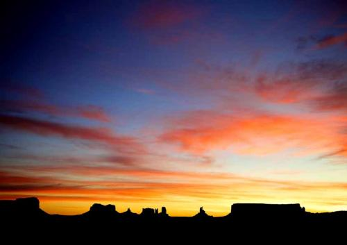 Sunrise at Monument Valley Navajo Tribal Park, border between Ar